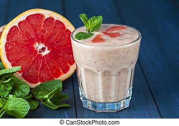 Glass of homemade smoothie with grapefruit, banana and mint leaves . Conception of healthy food. Nonalcoholic drinks.