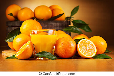glass of orange juice with fresh fruits on wooden table