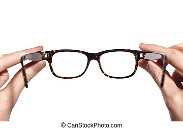 glasses with horn-rimmed in human hands isolated on white background