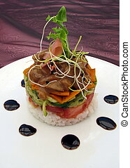 Gourmet Chicken and salad Food stacker on a plate with dots