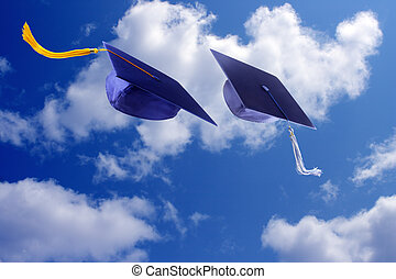 Graduation caps throwing in the air