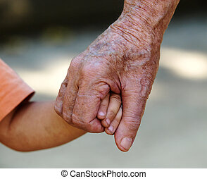 Grandfather holding hand of his grandchildren