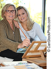 grandmother and granddaughter together at home