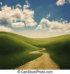 Pathway through the rolling grassy hills