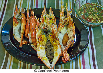 Grill prawns over hot charcoal 8