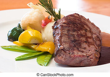 Juicy platter of beef steak served with mashed potatoes, carrots, beans and zucchini. Served with an assortment of sauces.