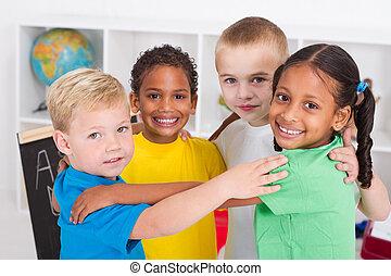happy preschool kids hugging