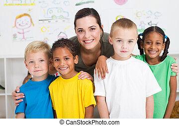 group of preschool kids and teacher in classroom