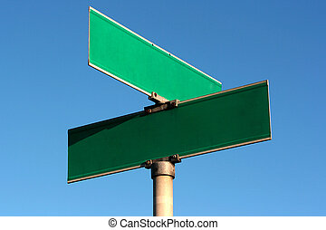 Pure guide sign of crossing of streets against the blue sky.
