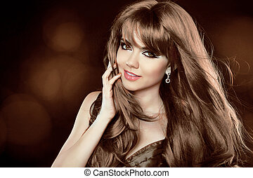 Hairstyle. Brown Hair. Attractive smiling girl with long Curly Hair. Happy smiling woman.