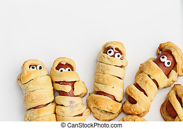 Halloween Mummy Hot Dogs Wrapped in Croissant Rolls