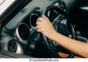 hand of woman on the wheel