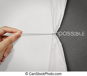 hand pull wrinkled paper show word impossible transformed into possible as concept