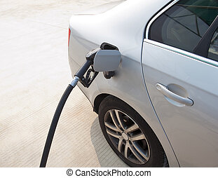 hand with fill up fuel at gas station
