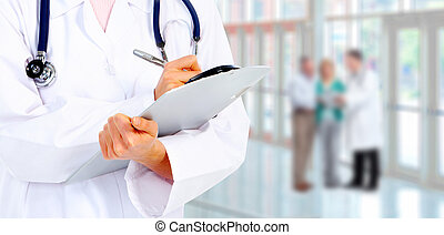 Hands of a medical doctor writing. Health care background.