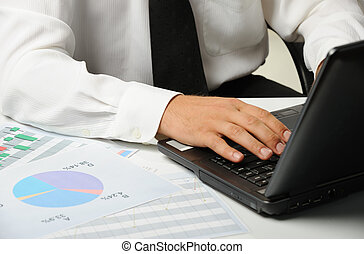 Hands of the businessman above the keyboard laptop