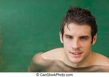 Handsome man in the swimming pool