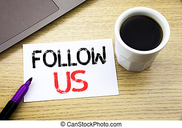 Handwriting Announcement text showing Follow Us. Business concept for Social Media Marketing written on notebook book on the wooden background in the Office with laptop coffee