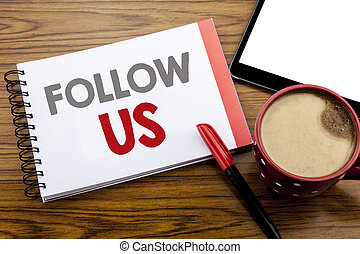 Handwriting Announcement text showing Follow Us. Business concept for Social Media Marketing Written on notepad note paper on wooden background with space office view with pencil marker