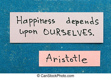 famous ancient Greek philosopher Aristotle quote interpretation with sticky notes on vintage carton board about happiness