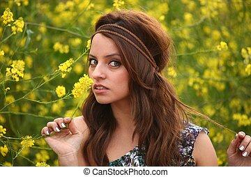 Happy Beautiful Woman in a Flower Field