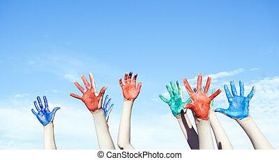 Happy children painted hands