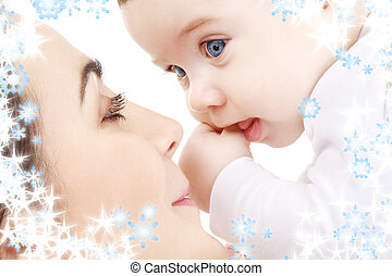 happy mother playing with baby boy