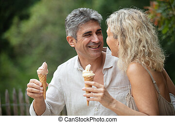 happy old couple eating ice-cream outdoor