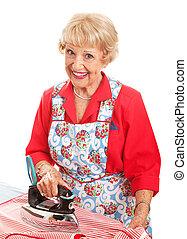Happy Senior Ironing