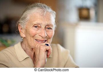 Happy senior woman portrait, close-up, shallow DOF.