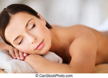 beautiful woman with closed eyes in spa