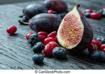healthy plums, berries and figs