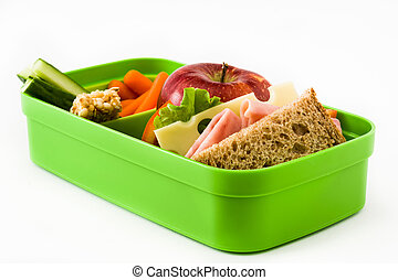 Healthy school lunch: Sandwich, vegetables and fruit. isolated on white background.