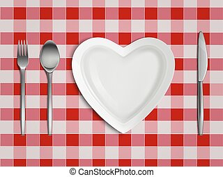 Heart shaped plate, fork, spoon and knife top view