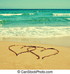 hearts in the sand of a beach