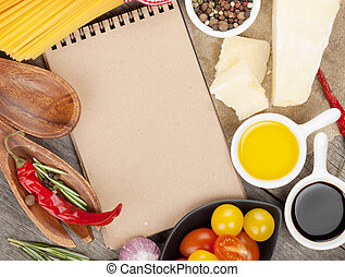 Herbs, spices and seasoning on wooden table background with notepad for copy space