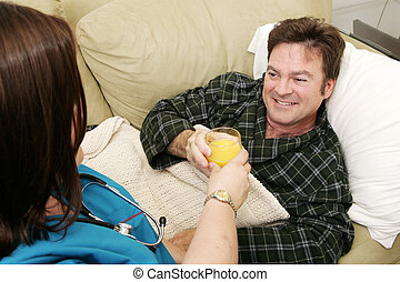 Man home sick taking a glass of orange juice from his home health nurse.