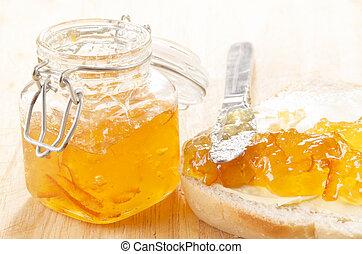 home made orange marmalade on a slice toast bread