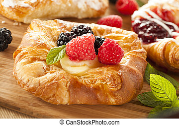 Homemade Gourmet Danish Pastry with berries and icing