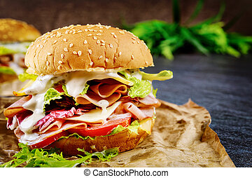 Honey ham sandwich with lettuce, tomato and cheese.