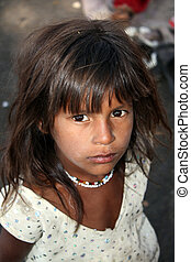A portrait of a very poor Indian girl with hopeful eyes.
