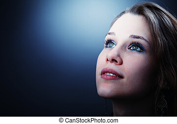 Hopeful young cute woman glancing into her future