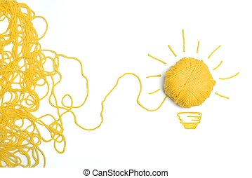 Concept of idea and innovation with wool ball