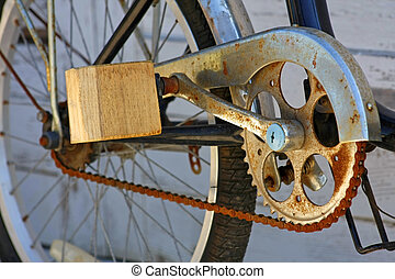 wooden pedal of old bike with rusty chain