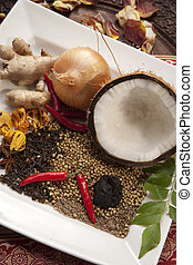 Collection of spices and ingredients used in Indian dishes.