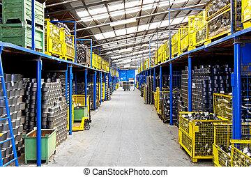 Interior of big warehouse in metal factory
