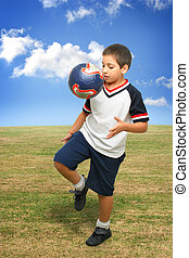 Kid playing soccer outside