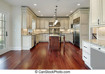 Kitchen in new construction home with cherry wood floor