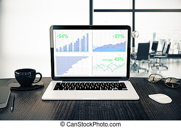 Laptop with business graphs
