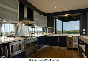 An interor view of a large, deluxe family kitchen